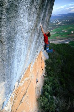 Long way above his last draw, Chris Sharma double dynos to a flat ledge.
