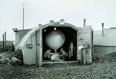 Army Air Force meteorologists prepare to launch hydrogen-filled balloon Balloon transported radiosonde that transmitted back to station Radiosonde measured temperature, humidity, and pressure This instrument was used up until just before the end of WWII Iceland post important for shipping and forecasting for European operations    Image ID: wea01105, NOAA's National Weather Service (NWS) Collection  Location: Iceland, Meeks Field Photo Date: 1944? Photographer: United States Army