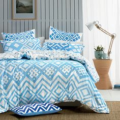 Bring a sunny, Mediterranean feel to the bedroom with this fresh, blue and white print inspired by thoughts of a luxury coastal getaway. Torquay features a stylish abstract design, incorporating a modern chevron and diamond print. Finished with a piped trim, Torquay is complemented by a euro pillowcase and cushion covers in deeper shades of blue. The quilt cover has button closure and a small, diamond print reverse.