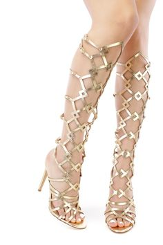 These sexy and stylish single sole gladiator sandal heels are a must have this season! The features include a faux leather upper in a strappy design with a front lace up tie design, peep toe, stitched trim, back zipper closure, smooth lining, and cushioned footbed. Approximately 4 1/4 inch heels, 14 1/2 inch circumference, and 15 inch shaft.