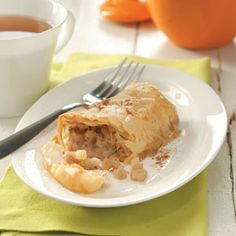 Mini Apple Strudels Recipe -Crisp sheets of phyllo dough surround tender slices of apple in this clever play on strudel. Walnuts and cinnamon enhance that traditional apple pie flavor. —Taste of Home Test Kitchen