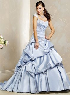 Wedding dress made of satin shown in blue basically features ball gown silhouette, short cap sleeves on scoop neckline. Appliques are heavily embellished around neckline and cap sleeves. Ruched bodice features diagonally cut waistline. Pick up details are featured throughout the skirt to add volume and drama. Lace up back with chapel train. More colors available shown in Color Options. Custom-to-measurement for any size.