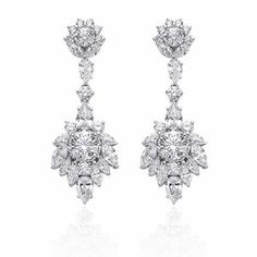 NEW: Christopher Designs diamond dangle earrings featuring two Crisscut® round diamonds 1.07ctw and clusters of marquise shaped, pear shaped and round brilliant cut white diamonds 4.79ctw set in 18k white gold. #jewelry #newyork #diamondjewelry #love #beautiful