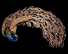 "Mellerio dits Meller ""Paon Royal"" head dress in gold and platinum with cloisonné-enamel and diamonds. 1905"