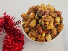 Nuts and Bolts Crunchy Snack Mix Nuts and Bolts make for a deliciously different snack to chips and make excellent nibble foods. They are tasty, and you can't stop at just a handful Nut Recipes, Dog Food Recipes, Cooking Recipes, Christmas Nibbles, Christmas Foods, Merry Christmas, Xmas, Savory Nuts Recipe, Savory Snacks