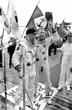 Astronauts James A. Lovell and Edwin E. Aldrin Jr. are welcomed aboard the aircraft carrier U.S.S. Wasp after their Gemini 12 spacecraft splashed down in the Atlantic Ocean.