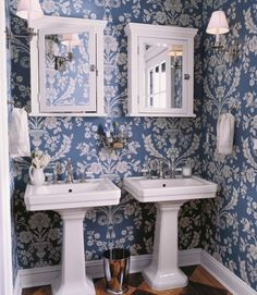 St. Antoine wallpaper in BP948 by Farrow & Ball. The symmetrical arrangement of the sinks and cabinets by A-Ball brings order to a small space. Minwax stain was applied for the bold diamond pattern on the floor.    Read more: Blue Rooms - Ideas for Blue Rooms and Home Decor - Country Living