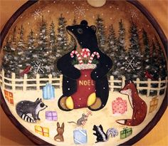 A wood bowlhas been hand painted with my primitive holiday design thatfeatures my original design of a black bear holding a stocking filled with goodies, which he is distributing to his friends - a fox, a raccoon, a skunk, a bunny and a little mouse. A couple of cardinals watch from the pine trees.   The rim and the exterior of the wood bowl, which measures approximately 9 1/2inches in diameter and two inches high, have been painted a country style mottled brown. The bowl is signed and…