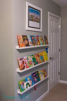 Ikea picture ledges for children's front facing book shelves. Such a nice way to show off all of Claire's books!