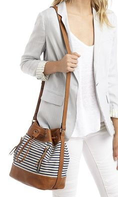 Mini bucket bag with a navy stripe canvas print and fun braided zipper pulls: