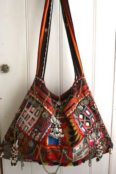 Make from Moroccan rug pieces, embellish with braid and ribbon short sections and old beads
