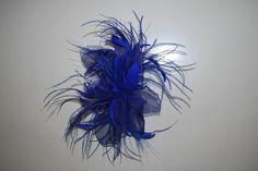 feathers and silk headpiece.siguenos en www.teresadeangoitia.com