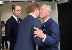 Prince Charles, Prince of Wales kisses his son Prince Harry as Prince William, Duke of Cambridge looks on ahead of the Invictus Games Opening Ceremony at Queen Elizabeth II Park on September 10, 2014