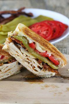 Baja Turkey Club. Sliced turkey, pepper jack, smokey bacon, green chiles, tomato, and a spicy aoli.