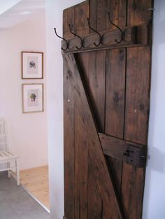We love the old, vintage objects and furniture. We made hat-and-coat rack from a vintage door. On the wall are Gábor Födő's graphics. ++ More information a