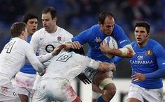 Bulldozing: Italy captain Sergio Parisse charges forward, and is tackled by his opposite number, Phil Dowson