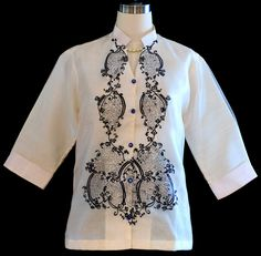 WOMEN'S BARONG #5101 DETAILS: Simply lovely. Delicate #embroidery create a remarkably #feminine aesthetic in our button-front #blouse. Color: Beige/Ecru Mandarin Collar WIth an attached lining With dark blue embroidery design 3/4  sleeves Semi fitted shape PRICE: $50.00  #filipinofashion #filipinostyle #filipinowedding #gettingmarriedinabarong #barongvstuxedo