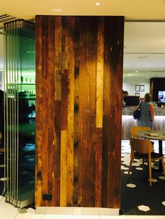 PHOTO 4: Reclaimed wood used in commercial  settings, like this cafe, are quite trendy now and are a more environmentally sound choice for panels.