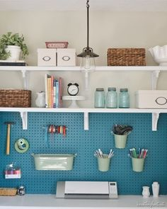 Shelves above pegboard to make maximum use of space. Use to store extra office supplies or old files. www.respacedpdx.com