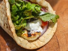 Grilled Halloumi Pita Sandwiches- Salty halloumi cheese browns beautifully on the grill and is perfect for making filling pita sandwiches with tomato, red onion, lettuce, and creamy tzatziki.