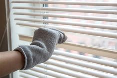 Spring cleaning hacks - dust your blinds with an old sock
