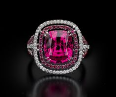 Spinel Ring    The vibrant color in our 5.20 carat spinel trimmed with diamonds and spinel shows why fine stones like this are becoming among the most sought after by fine jewelry collectors.