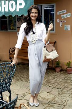 Sonam Kapoor in half haram pants and a white blouse.