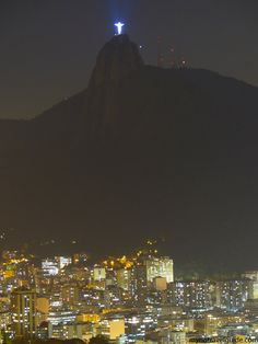 Christ the Redeemer Statue and Rio de Janeiro lights at night - Brazil travel tips!