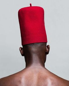 """For Nigerian men, a hat adds a sense of confidence, it's like a personal crown,"" says @LakinOgunbanwo, a Nigerian photographer whose portraiture edges fashion and culture into the spotlight. Click the link in our bio for more."