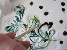 marbleized paper with shaving cream. Maddie loves this and can almost do it all by herself