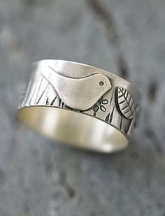 In The Garden Silver Ring Are you interested in our handmade silver bird ring? With our wide silver band ring you need look no further.Are you interested in our handmade silver bird ring? With our wide silver band ring you need look no further.