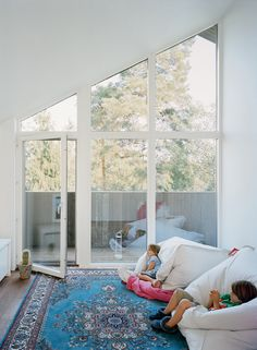 Love the windows, sloped ceiling and the fatboys. Comfy, no? (Could be a playroom, too.) Claesson Koivisto Rune, in Dwell.