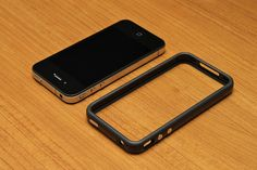 iPhone 4 32GB Black with Black Bumper. It also improves the signal quality by isolating the antenna from the hand.    With the bumper, the headphone jack is recessed just like in the original iPhone. That might become an issue for some people including Hmm I like