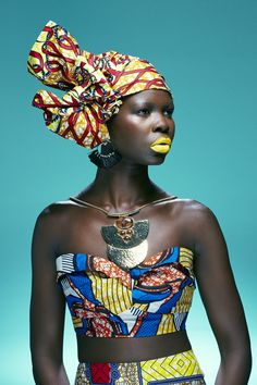 Model Achan wears our headwrap TONI teamed with a colourful African print ensemble designed by her sister Adeng.