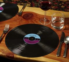 Gamago Record Placemats / Don't Scratch up your table, use this set of two dishwasher-friendly silicone record placemats to lay down the right groove for dinner.  http://thegadgetflow.com/portfolio/gamago-record-placemats-12/