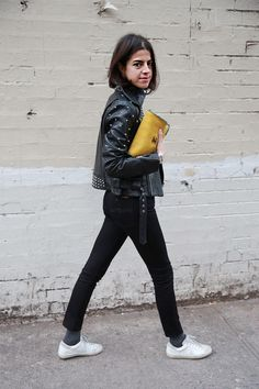 Shop this look on Lookastic:  http://lookastic.com/women/looks/low-top-sneakers-socks-skinny-jeans-turtleneck-biker-jacket-clutch/7717  — White Low Top Sneakers  — Charcoal Socks  — Black Skinny Jeans  — Black Turtleneck  — Black Studded Leather Biker Jacket  — Tan Leather Clutch
