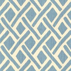 Fabric with unique blue shapes over off white