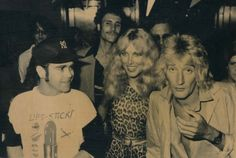 Elton John (left), Lana Hamilton, wife of actor George Hamilton (center) and rock singer Rod Stewart arrive at New York's Studio 54 on July Rod Stewart, Chez Regine, Studio 54 Nyc, George Hamilton, Hairy Chest, Sport, Music Artists, Rock N Roll, Sexy Men