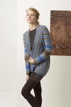 The cardigan is knit in one piece sideways, from cuff to cuff.