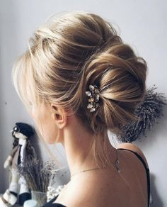 #18: Romantic Braided Updo for Thin Hair Long thin hair can sometimes be tricky to style. You do not want your locks to appear too flat when they're pulled back