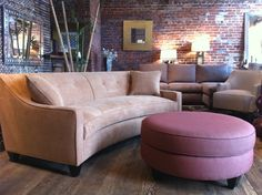 Curved sofa with round ottoman