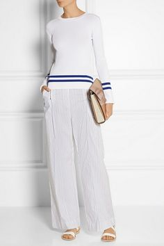 Wide-leg pants continue to be a key style this season. Dion Lee's striped cotton-blend pair has an elasticated waistband and zip-fastening front pleats. Wear yours with a tucked-in sweater and sandals.