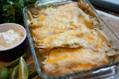 Enchiladas Verdes recipe - This is one of my all-time favorite dinners. I love everything about these enchiladas. The tang from the tomatillos and punch from the limes and cilantro are so amazing. #holiday #enchilada #Mexican