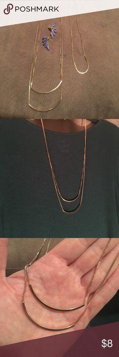 "2 gold necklaces & 1 pair of gold/purple earrings Set of 3 pieces of costume jewelry. 1. Long connected double strand necklace 26""-28"" 2. Short gold chain 17""-20"" 3. Gold/purple post earrings. All in good shape! Jewelry Necklaces"
