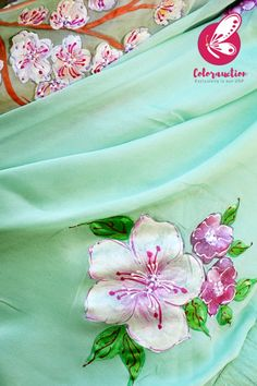 Colorauction brings to you this beautiful Pistachio Green Pure Silk Chiffon Handpainted Saree. This one of a kind saree is paired with a pink crepe sequins hand embroidered blouse piece. The saree is sure to make you the highlight of the occassion. Hand Painted Sarees, Hand Painted Fabric, Chiffon Fabric, Silk Chiffon, Kalamkari Painting, Drape Sarees, Fabric Paint Designs, Dress Painting, Purple Hands