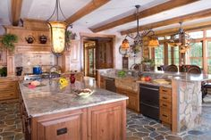 Double islands, stone floor, nice light fixture and rafters