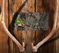 "Realtree Camo License Plate features John Deere trademark on officially licensed Realtree Camo pattern. Measures 12"" x 6""."