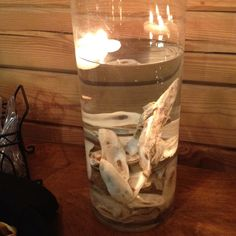 Oyster roast centerpiece with floating candles by Rachel