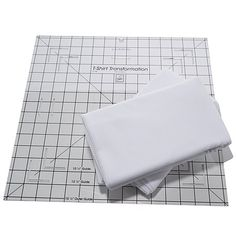 June Tailor T-Shirt Quilt Kit HSN - T-shirt transformation ruler (15-1/2x15-1/2), and 2 pkgs of 72inchx60inch fusible interfacing + 3 quilt patterns included with the ruler.  $44.00+$6.50 shipping