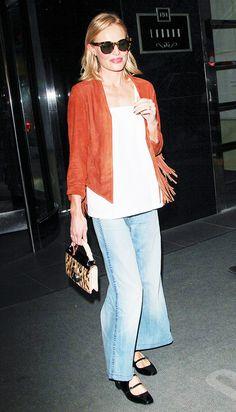 Kate Bosworth in an orange fringe jacket + flared jeans + black flats